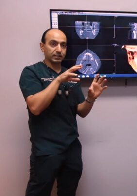 Doctor Modarres presenting patient treatment in consultation room