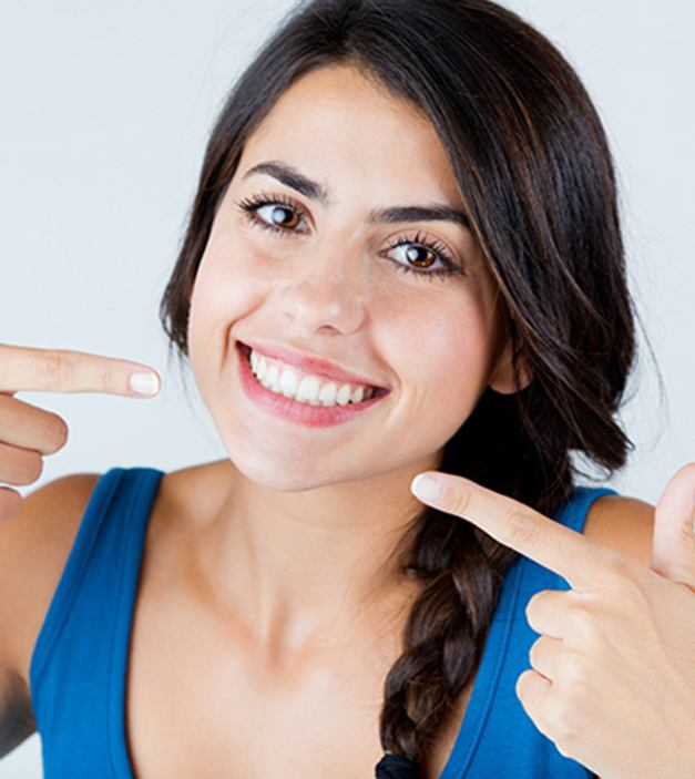 Woman with beautiful smile thanks to prosthodontics in Ellicott City