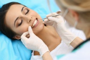 cosmetic dentist treating patient for gum disease